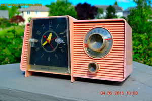 SOLD! - July 10, 2015 - POWDER PINK Mid Century Jetsons 1959 General Electric Model C-406A Tube AM Clock Radio Totally Restored! - [product_type} - General Electric - Retro Radio Farm