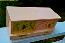 Load image into Gallery viewer, SOLD! - Sept 26, 2016 - POWDER PINK Vintage Antique Mid Century 1961 Arvin Model 51R23 Tube AM Clock Radio Restored and Rare!