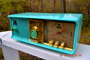 SOLD! - Dec 13, 2016 - VIVID Turquoise Retro Jetsons 1957 Motorola 57CC Tube AM Clock Radio Totally Restored! - [product_type} - Motorola - Retro Radio Farm