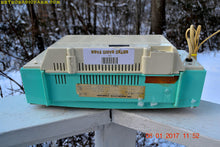 Load image into Gallery viewer, SOLD! - Dec 1, 2017 - STUNNING AQUA BLUE Mid Century Retro Jetsons 1957 Magnavox C5 Tube AM Clock Radio Works Great! - [product_type} - Magnavox - Retro Radio Farm