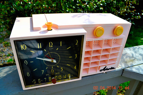 SOLD! - Mar 11, 2017 - POWDER Pink Mid Century Retro Jetsons 1957 Arvin 5561 Tube AM Clock Radio Works Great!
