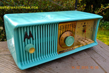 Load image into Gallery viewer, SOLD! - Feb 21, 2016 - VIVID Turquoise Retro Jetsons 1957 Motorola 57CC Tube AM Clock Radio Totally Restored! - [product_type} - Motorola - Retro Radio Farm