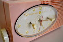 Load image into Gallery viewer, Dolly Pink Retro Space Age 1957 Sylvania Model 6002 Vacuum Tube AM Clock Radio Looks and Sounds Great!