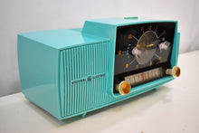 Load image into Gallery viewer, Ocean Turquoise 1957 General Electric Model 914-D Tube AM Clock Radio Sounds Great Popular Design