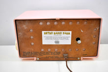 Load image into Gallery viewer, Pretty in Pink 1950s Philco AM Vacuum Tube Clock Radio Rare Never Before Seen Lighted Tuning Knob!