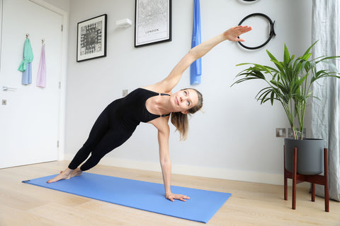 Dionne Blue Pilates in a Side Bend