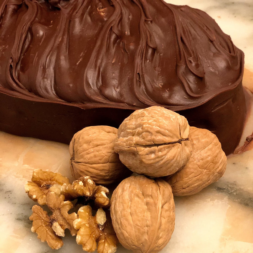 Walnut fudge loaf with nuts on a marble table