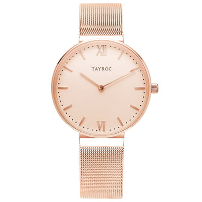 An all rose gold watch for women featuring mesh strap, analogue design and all rose gold materials.