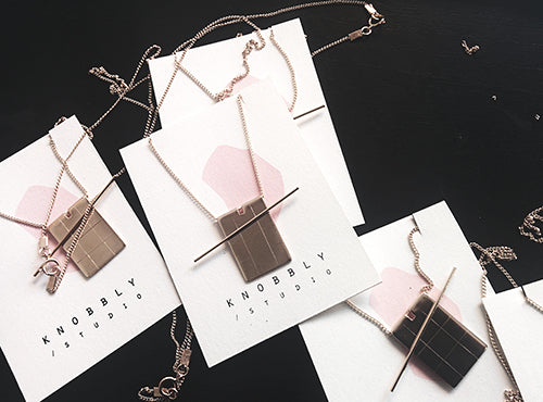 Grid+Lever necklaces pinned on our new screen printed cards.