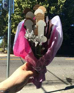 Photo of a dick bouquet in a girl's hand on the street