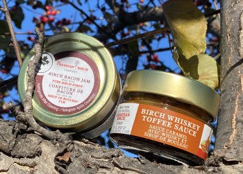 Birch Whiskey Toffee Sauce and Birch Bacon Jam in a tree on a sunny day