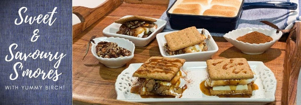 """Delicious white chocolate, birch whiskey toffee sauce and cinnamon s'mores as well as chocolate, birch whiskey toffee and pecan s'mores on a nice wooden tray with toasted marshmallows in the background. The captions says """"Sweet & Savory S'mores"""" to introduce the blog article that follows."""