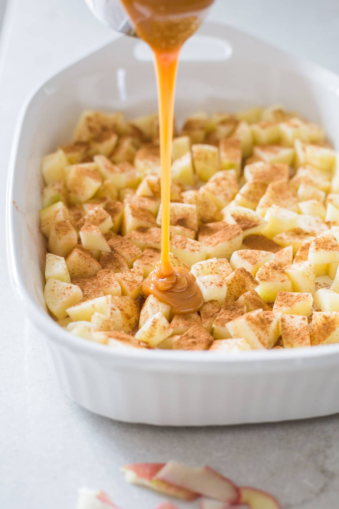 Miss Jones Caramel Apple Pie Dump Cake with caramel drizzled on top of the apples
