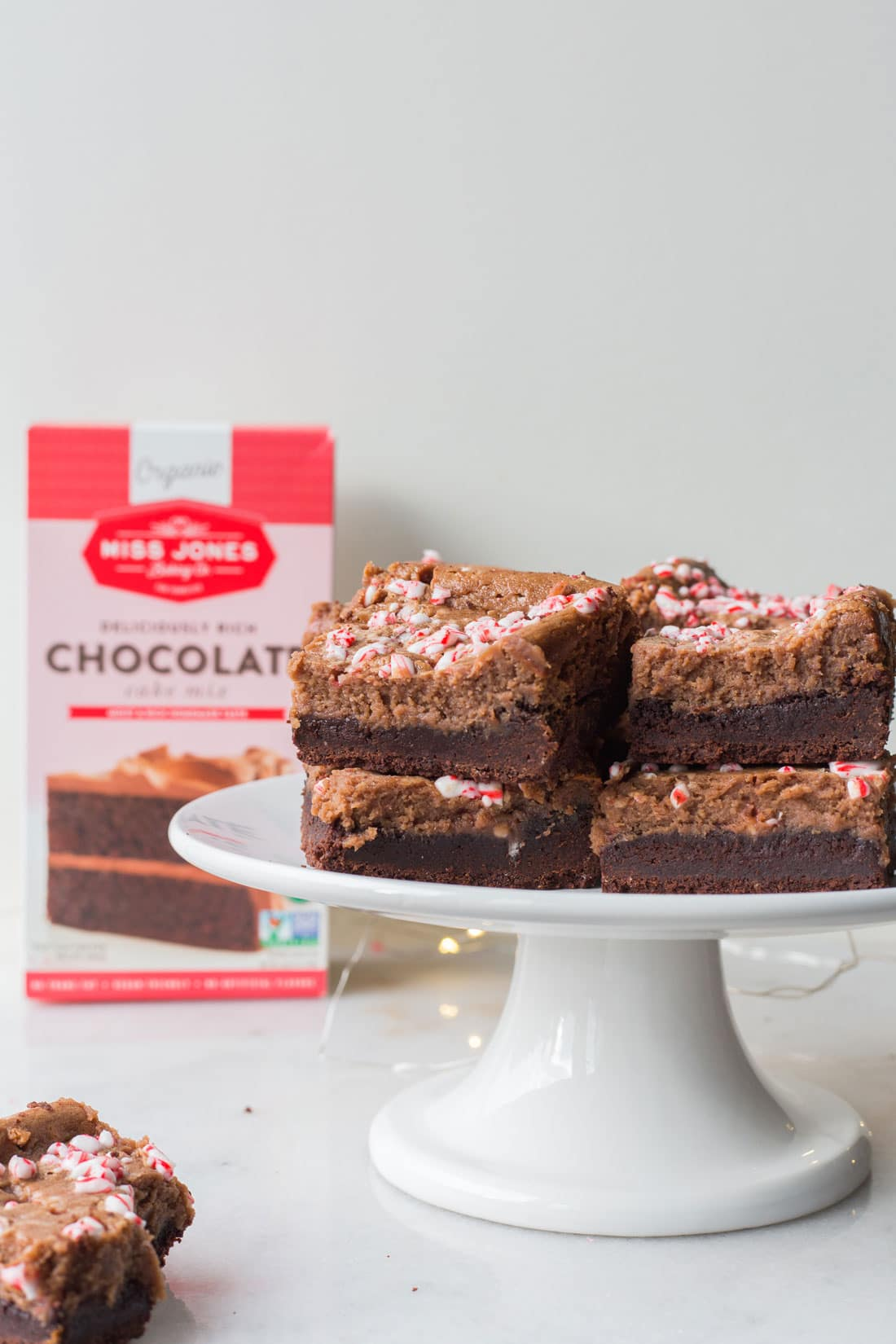 Side picture of Miss Jones Baking Co Chocolate Peppermint Butter Bar side and Miss Jones Baking Organic Chocolate Cake Mix in the background