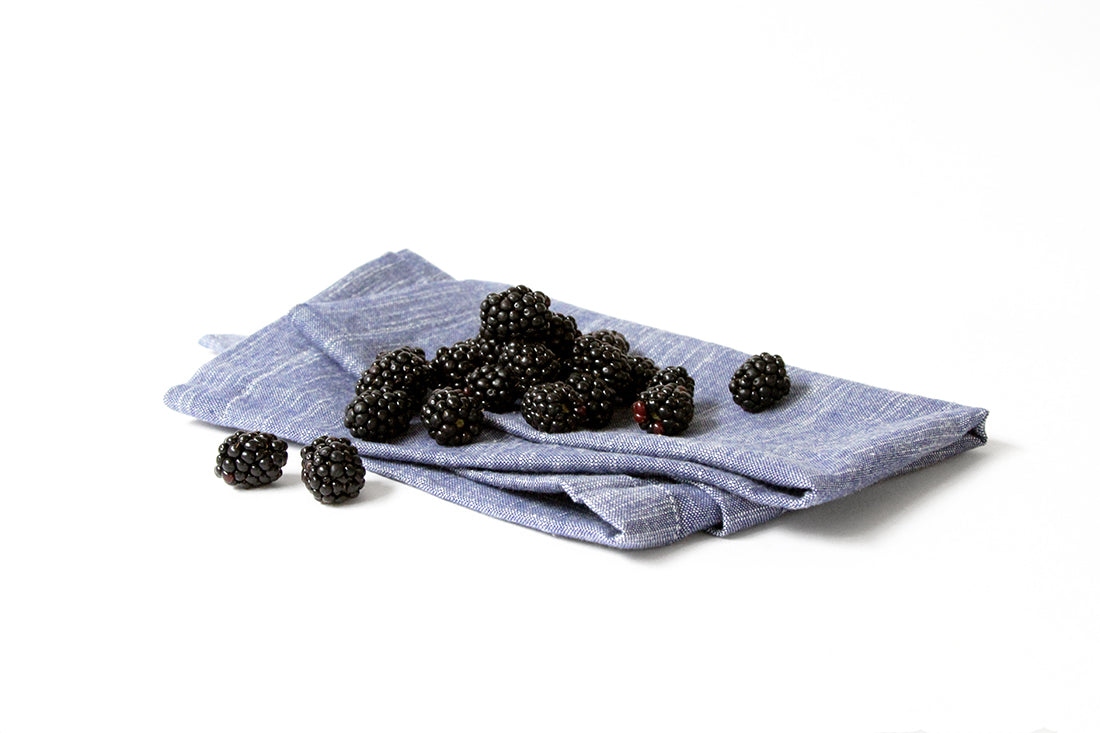 Image of blackberries on a towel used for Miss Jones Baking Co Blackberry Buttermilk Donuts