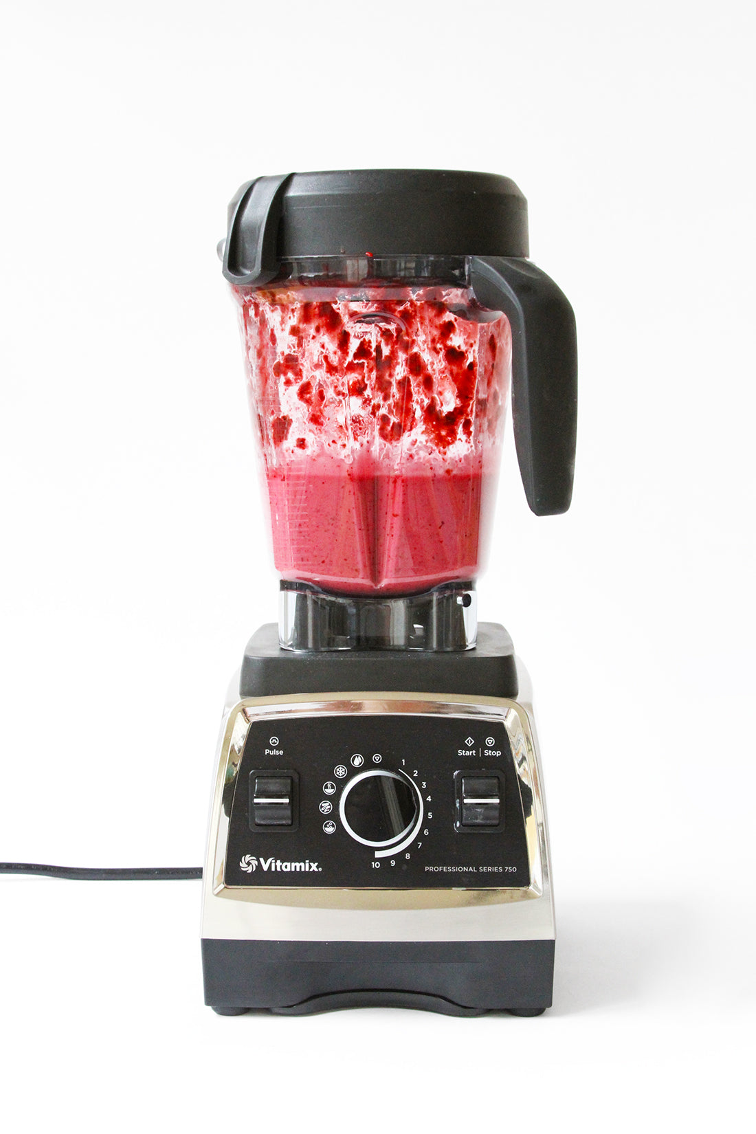 Image of blender with red glaze for Miss Jones Baking Co Blackberry Buttermilk Donuts