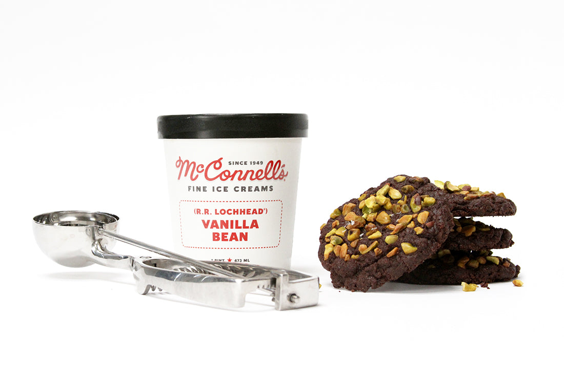 Image of four stacked Miss Jones Baking Co Brownie Crisp Cookies next to a pint of McConnell's Vanilla Bean Ice Cream