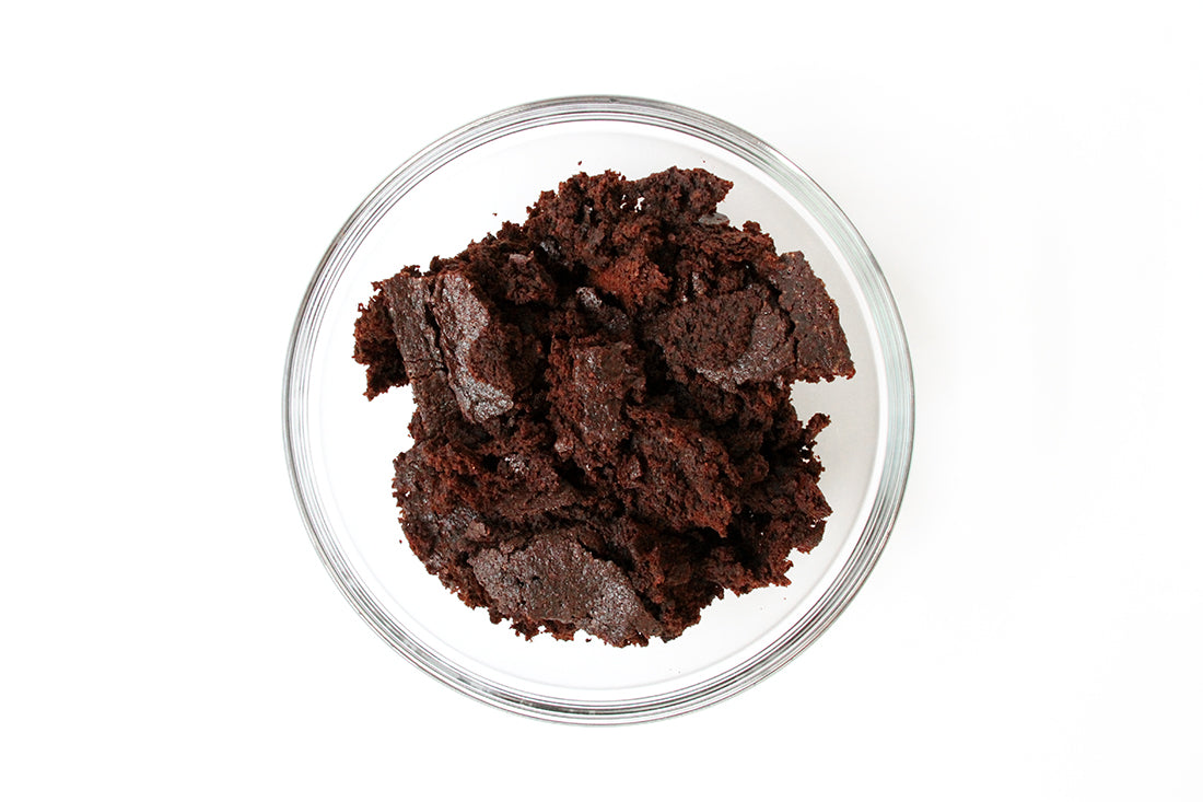 Image from above of brownie crumbles in a glass bowl used for Miss Jones Baking Co Coffee Break Shake
