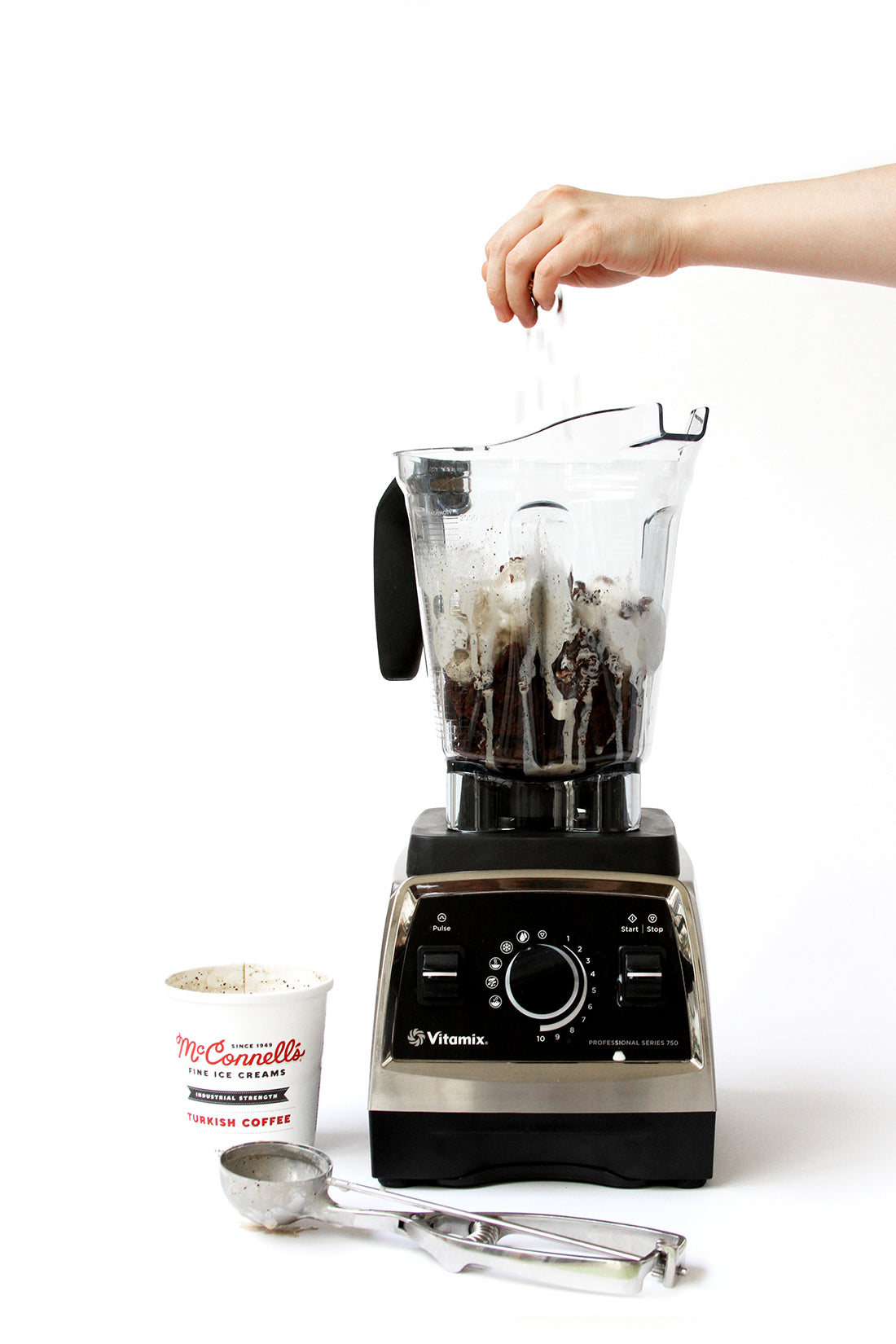 Image of a blender with ingredients for Miss Jones Baking Co Coffee Break Shake next to an ice cream scoop and a pint of McConnell's Fine Ice Cream