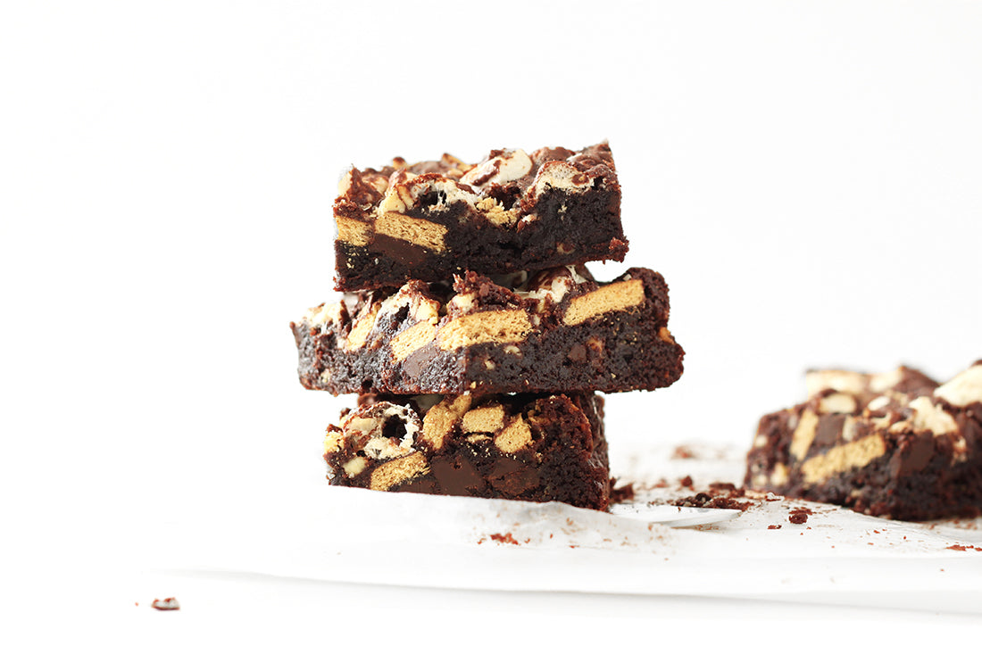 Image of three Miss Jones Baking Co Campfire Smores Brownies stacked next to a fourth