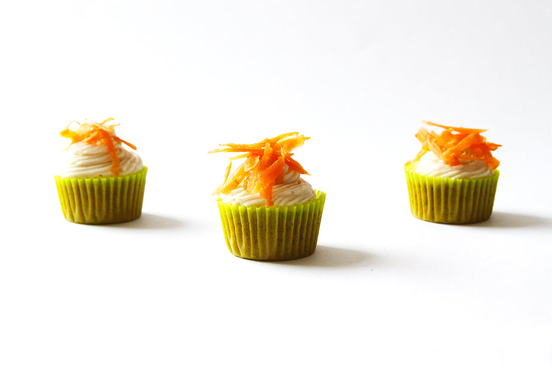 Image of three Miss Jones Baking Co Carrot Spice Cakes topped with shredded carrots