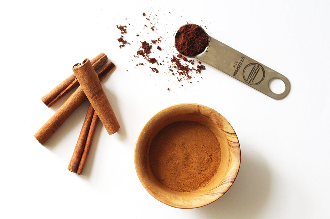 Image of cinnamon sticks, powder, and other spices used for Miss Jones Baking Co Carrot Spice Cakes