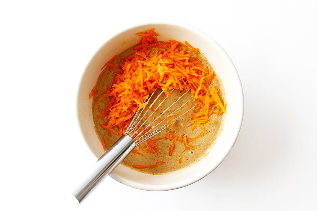 Image of shredded carrots being mixed into batter for Miss Jones Baking Co Carrot Spice Cake