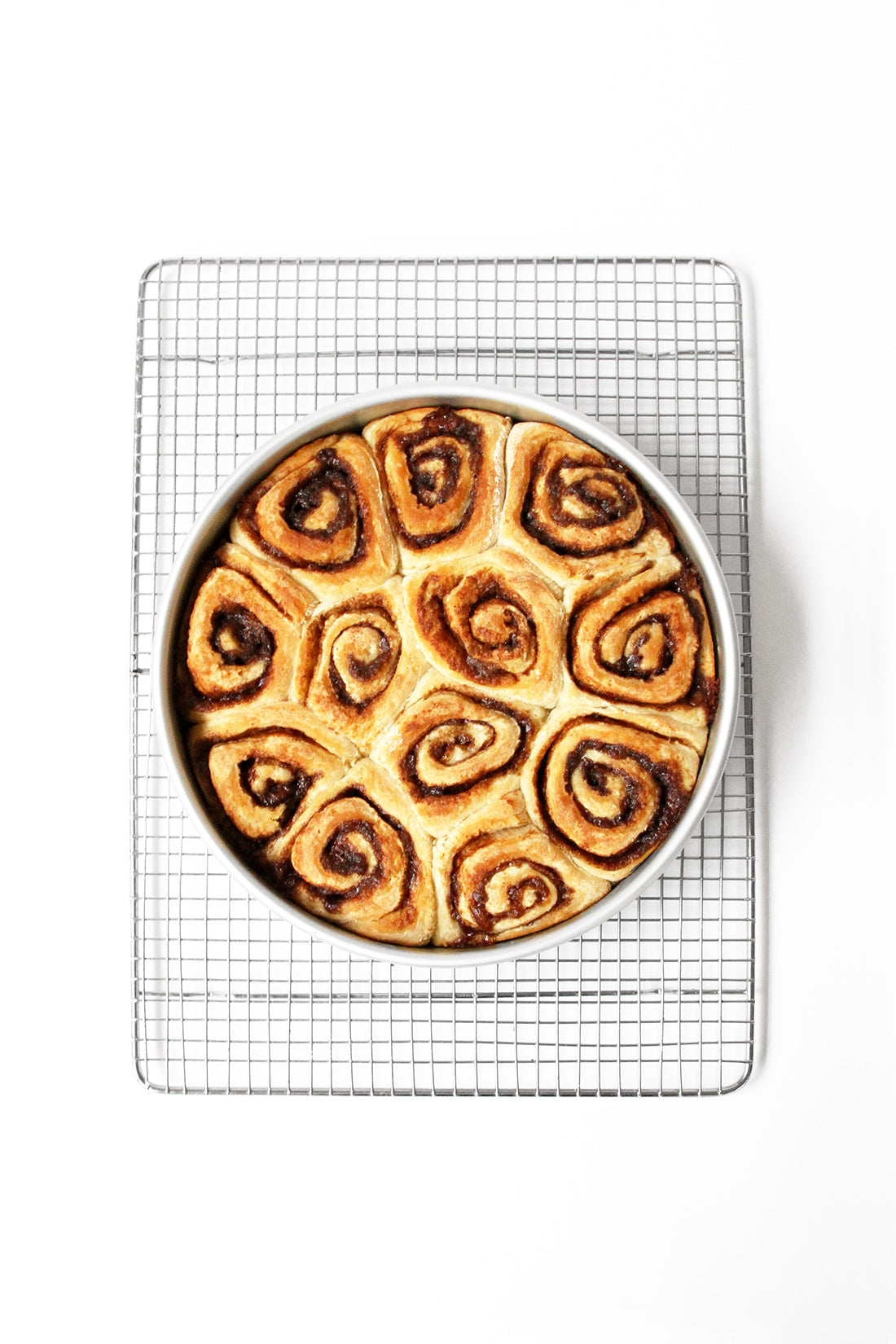 Image from above of a circular pan with twelve Miss Jones Baking Co Cake Mix Cinnamon Rolls