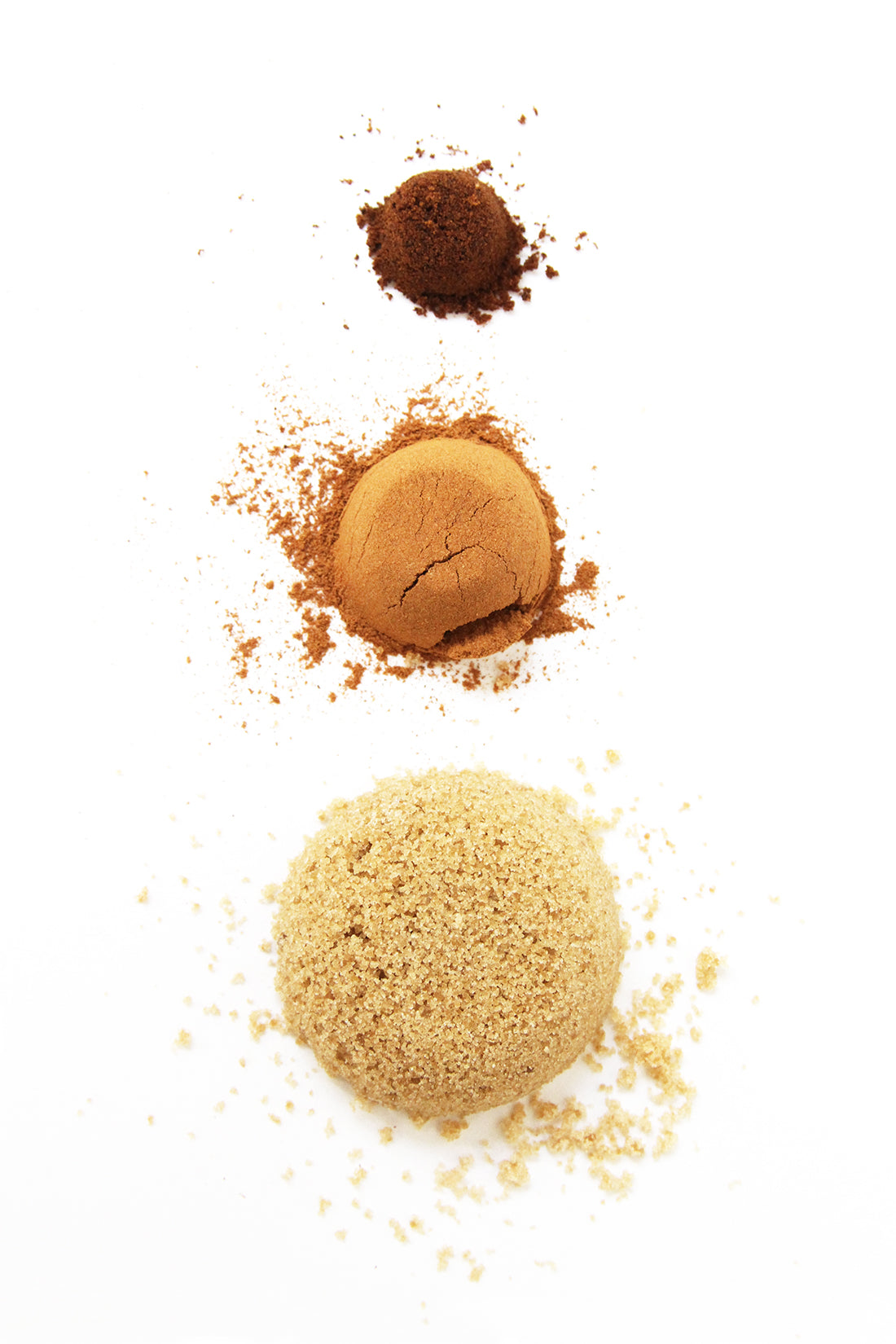 Image of three piles of nutmeg, cinnamon, and brown sugar in a vertical line used for Miss Jones Baking Co Cake Mix Cinnamon Rolls Recipe