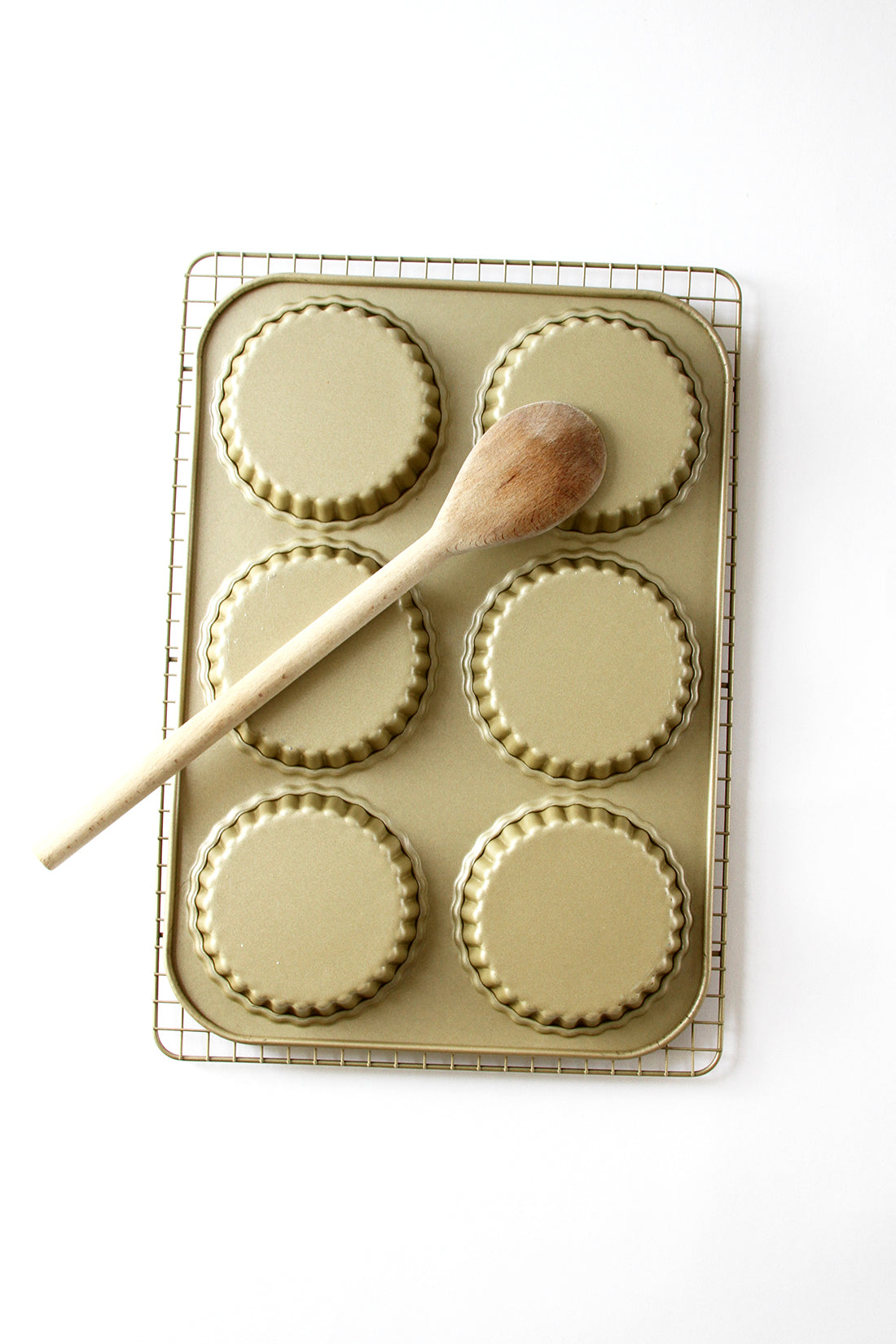 Image of a wooden spoon on the bottom of a baking sheet for Miss Jones Baking Co Fruit Cart Tarts recipe