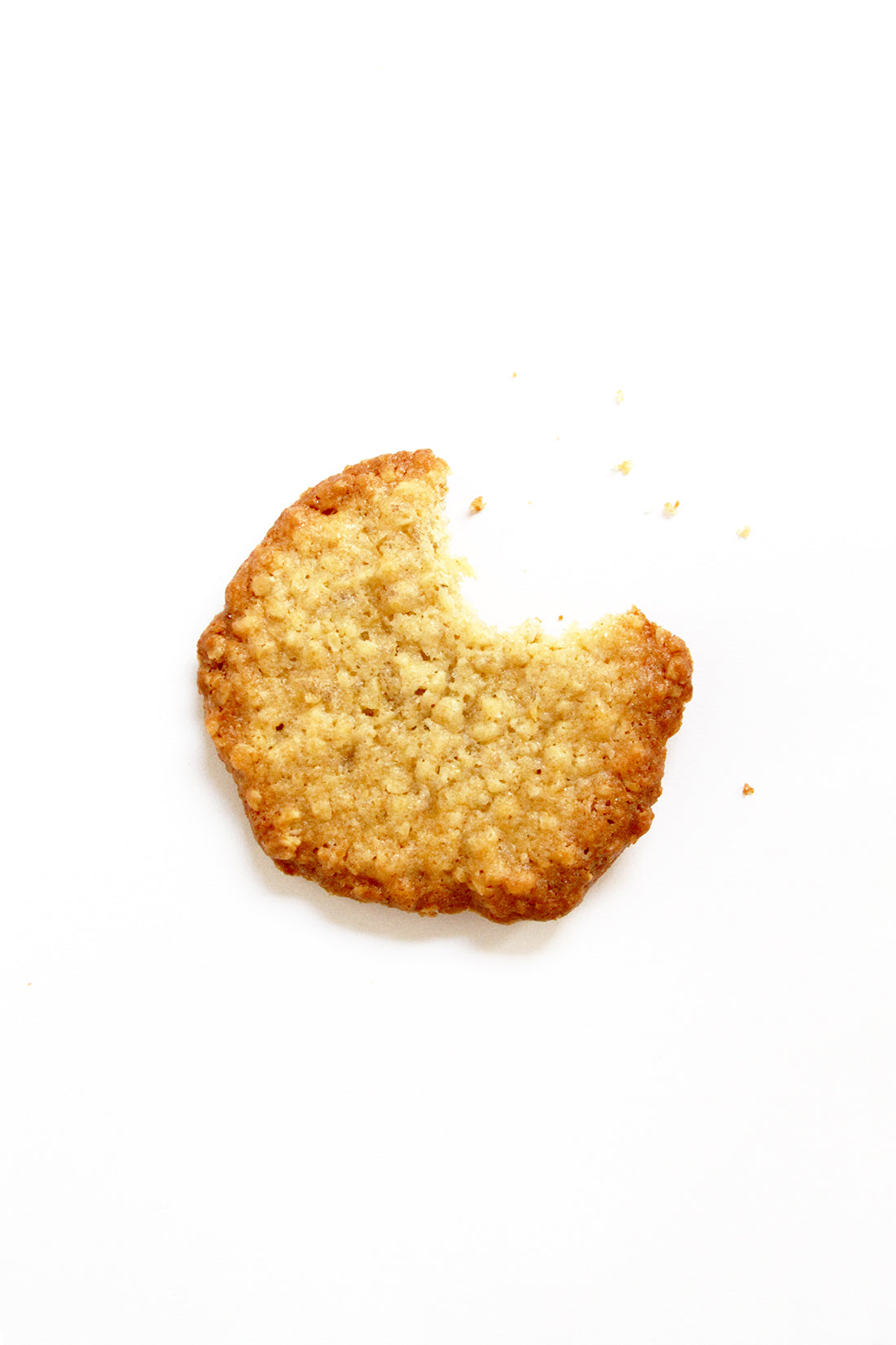 Image of the top of a Miss Jones Baking Co Ginger Oatmeal Drop Cookie with a bite taken out of it