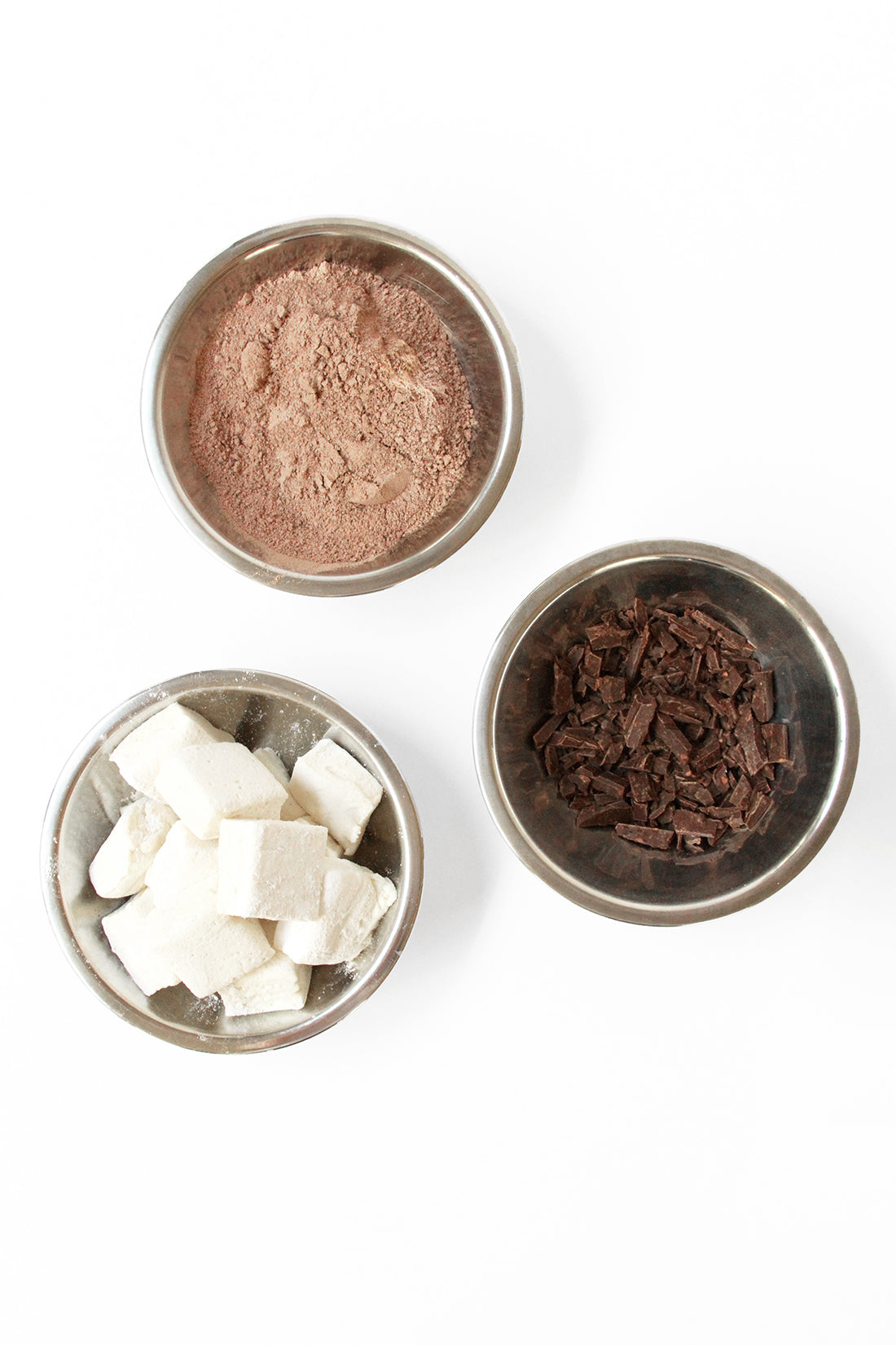 Image of three bowls of ingredients for Miss Jones Baking Co Hot Cocoa Mug Cake recipe