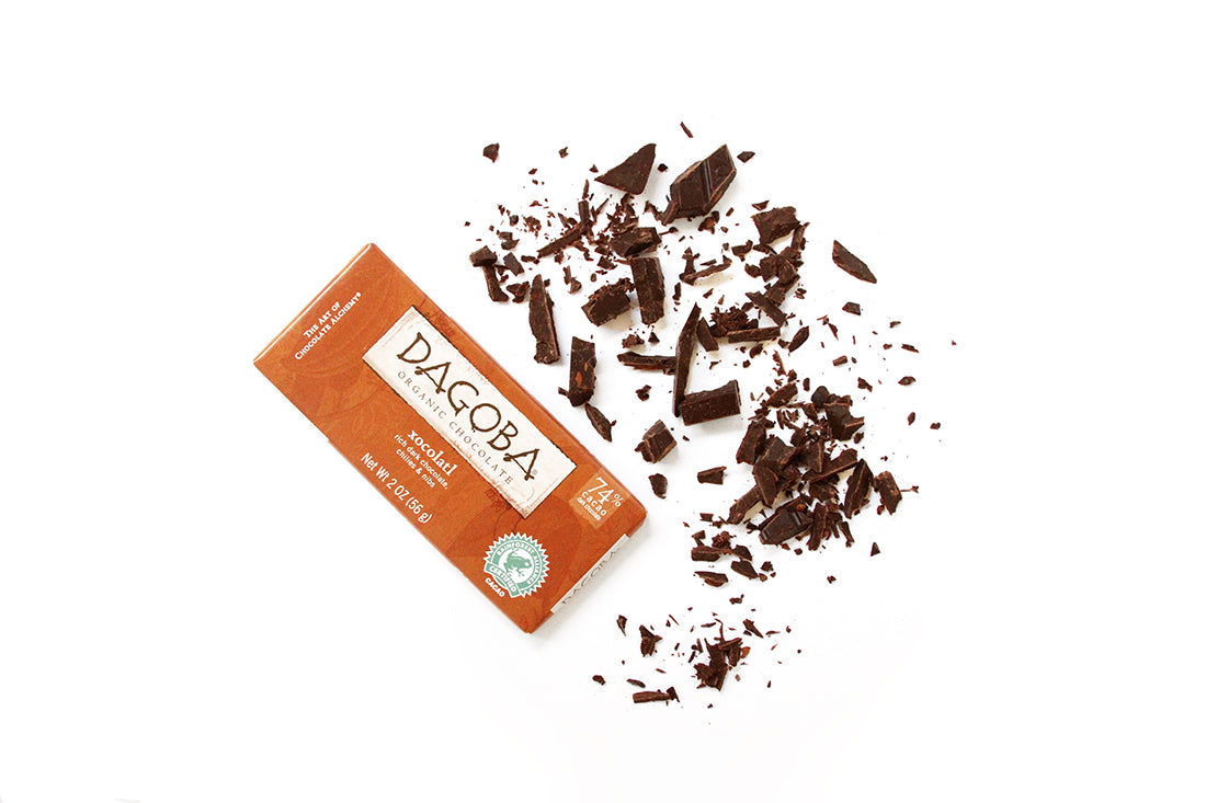 A bar of Dagoba xocolatl next to chopped up pieces of it for Miss Jones Baking Co Hot Cocoa Mug Cake