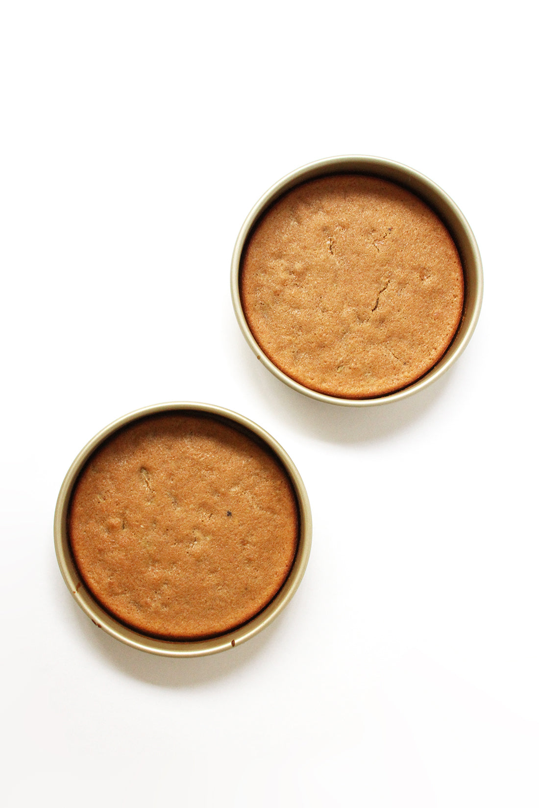 Image from above of two Miss Jones Baking Co Classic Hummingbird Cakes in cake pans