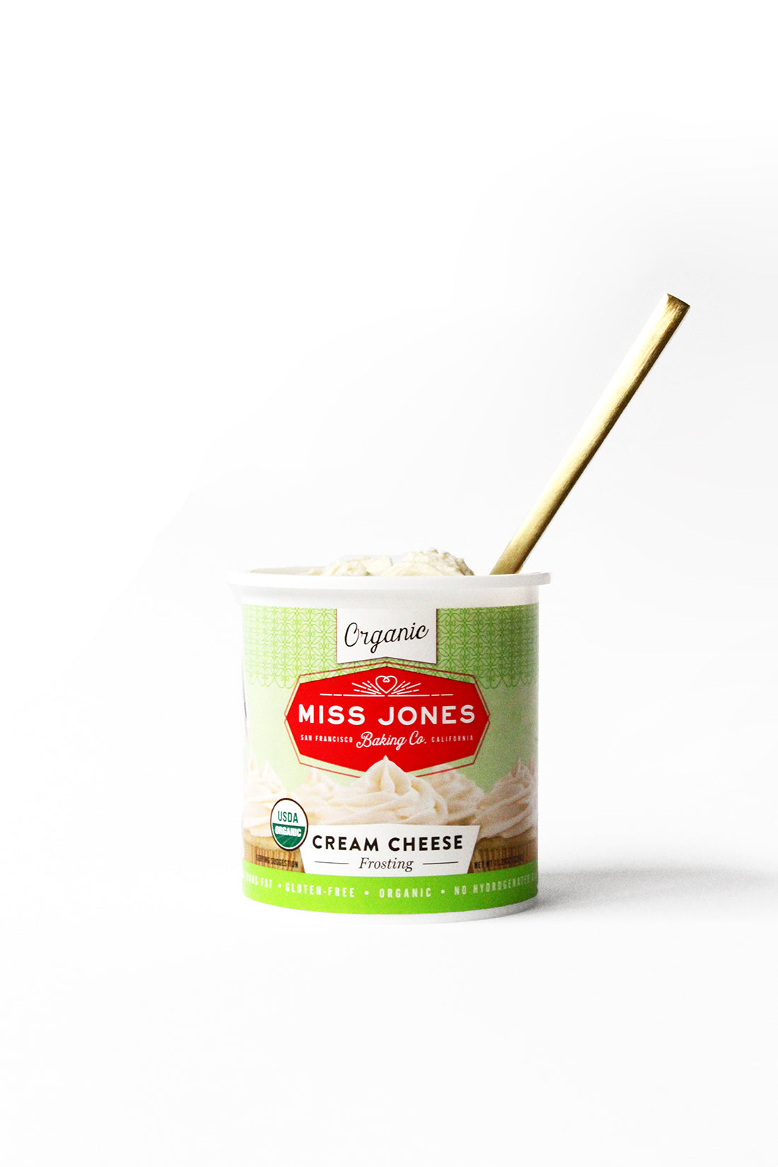 Image of Miss Jones Baking Co Cream Cheese Frosting with a gold spoon inside used for Miss Jones Baking Co Classic Hummingbird Cake