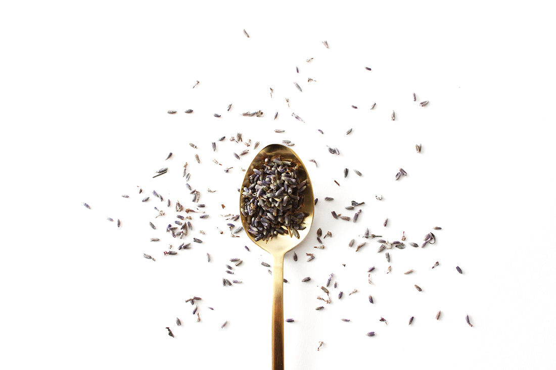 Image of a gold spoon full of lavender surrounded by dried lavender for Miss Jones Baking Co Lavender Lemon Bars recipe