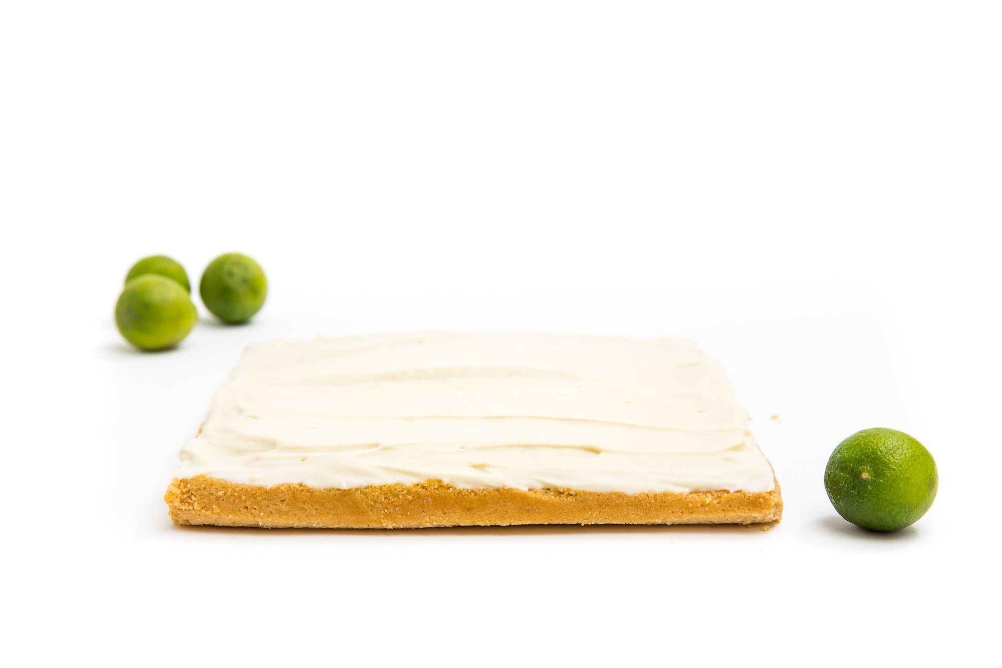 Image of Miss Jones Baking Co Key Lime Margarita Bars with four limes around it
