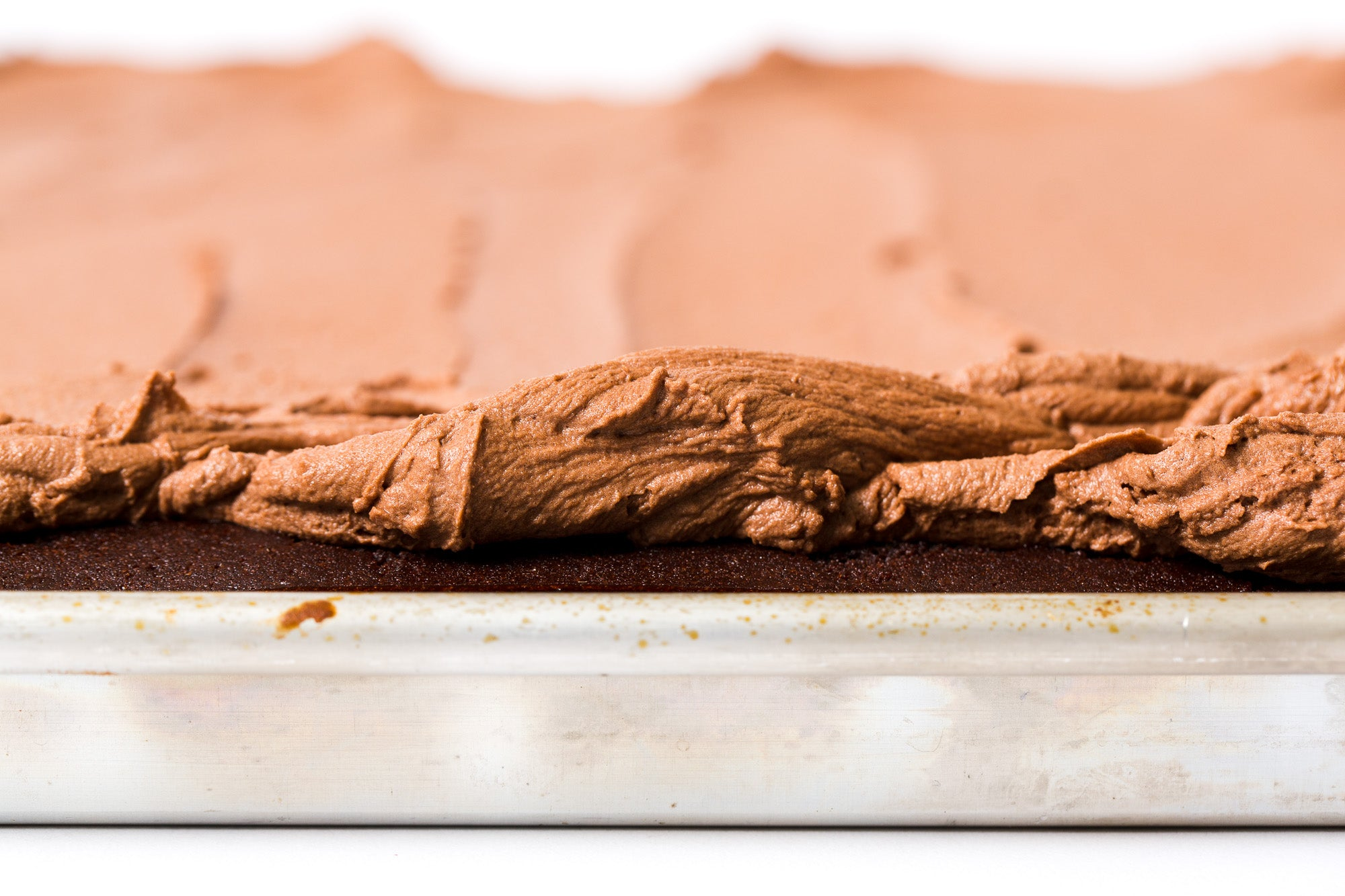 Close up of side of frosting on Miss Jones Baking Co Bourbon Chocolate Praline Sheet Cake