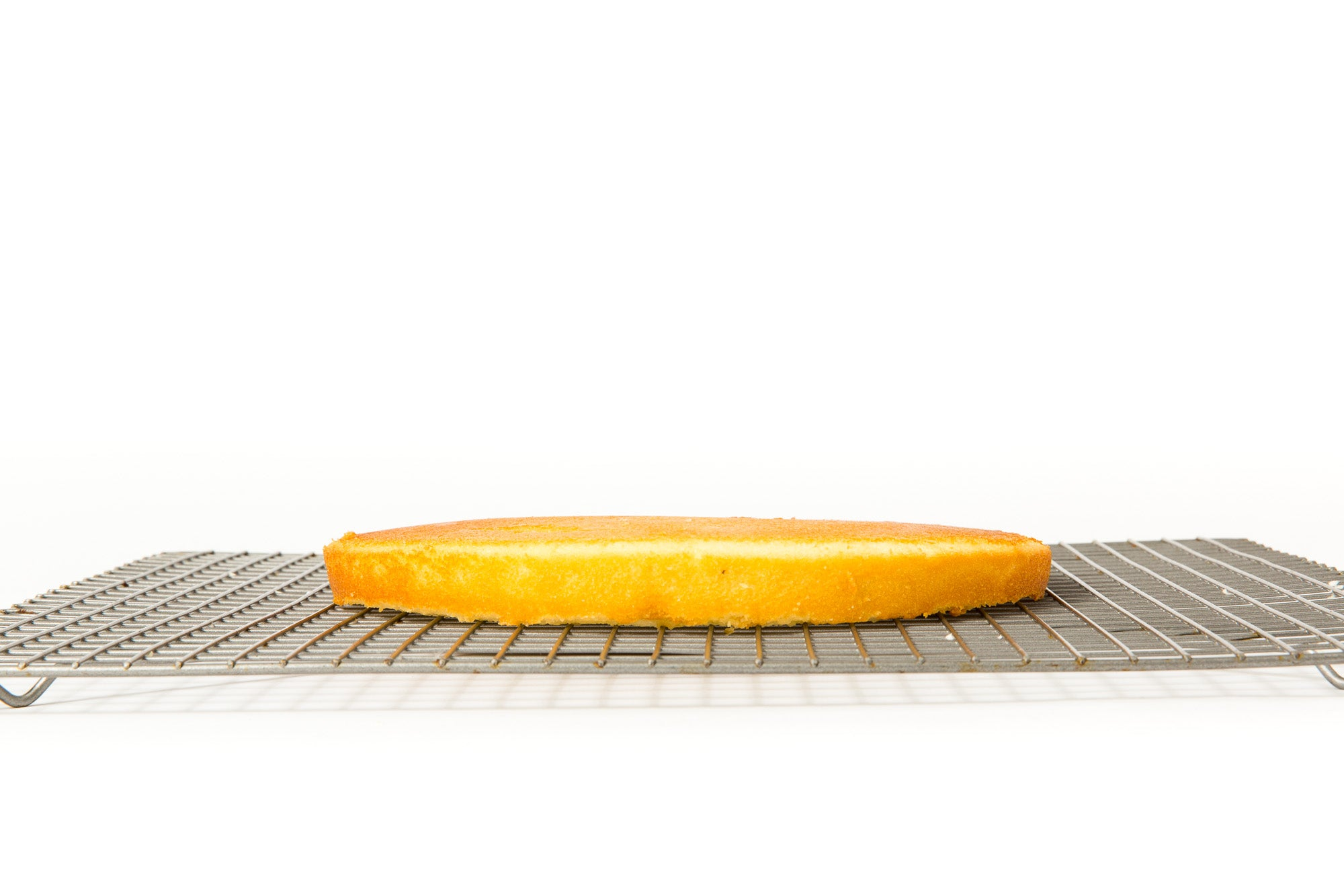 Image of the side of a layer of cake on a baking rack for Miss Jones Baking Co Floral Bloom Layer Cake