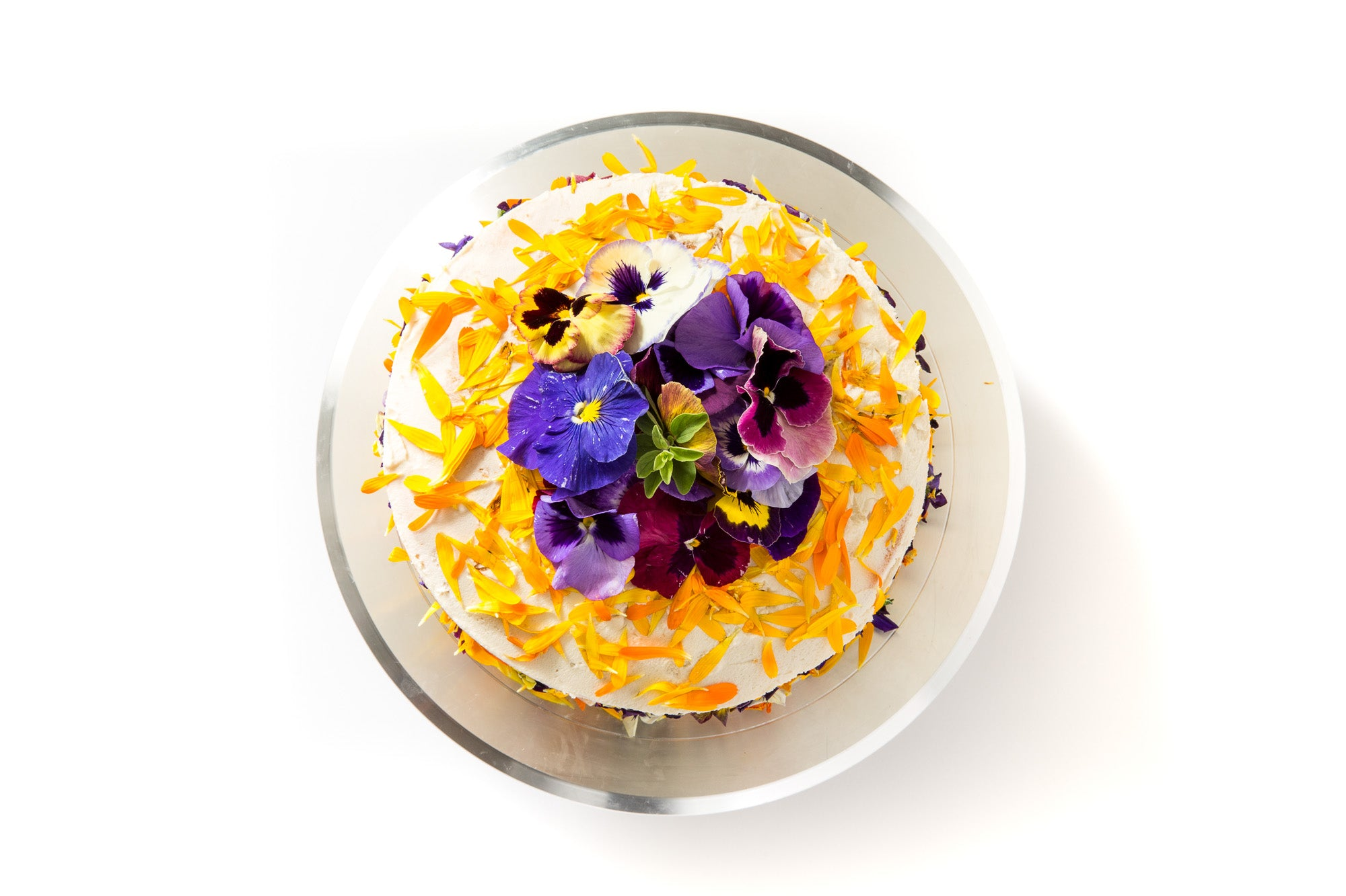 Image of the top of Miss Jones Baking Co Floral Bloom Layer Cake on a cake stand