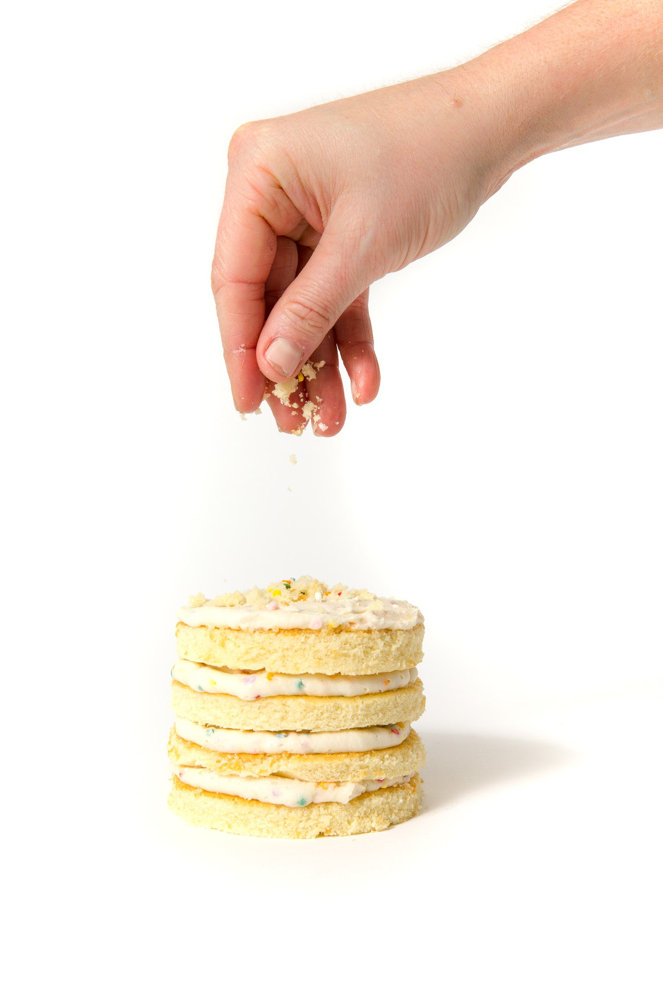 Side image of assembly of Miss Jones Baking Co Confetti Pop Mini Cakes