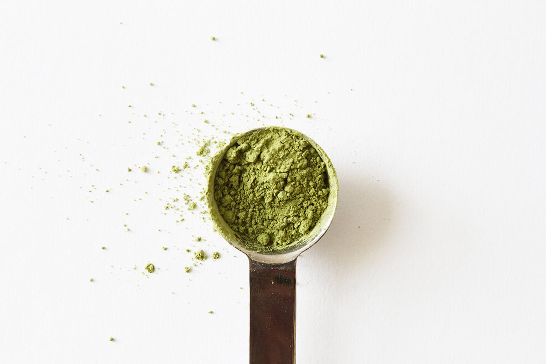 Image of a measuring spoon of matcha for Miss Jones Baking Co Matcha Tea Cakes recipe