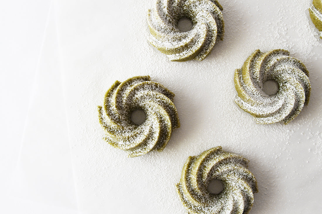 Image from above of four Miss Jones Baking Co Matcha Tea Cakes