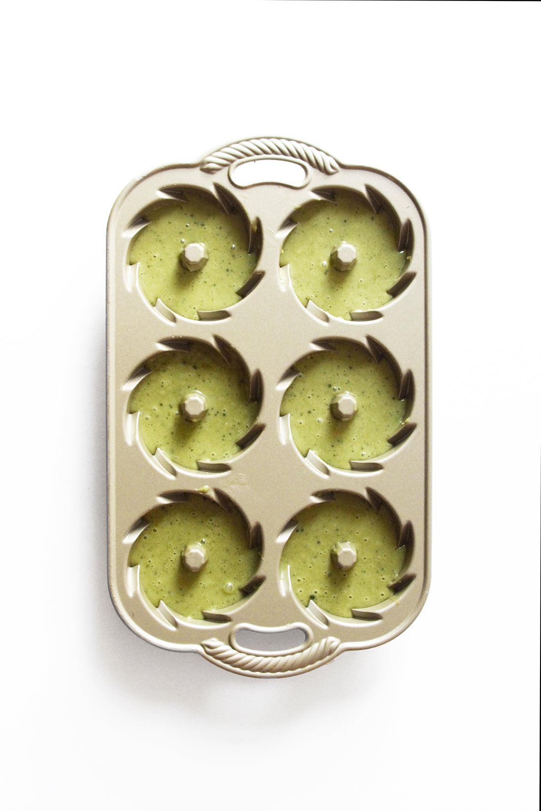 Image from above of Miss Jones Baking Co Matcha Tea Cakes batter in six cake molds