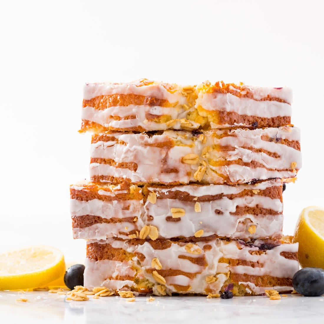 Stack of Miss Jones Baking Co Lemon Blueberry Muffin Bread with the lemon icing
