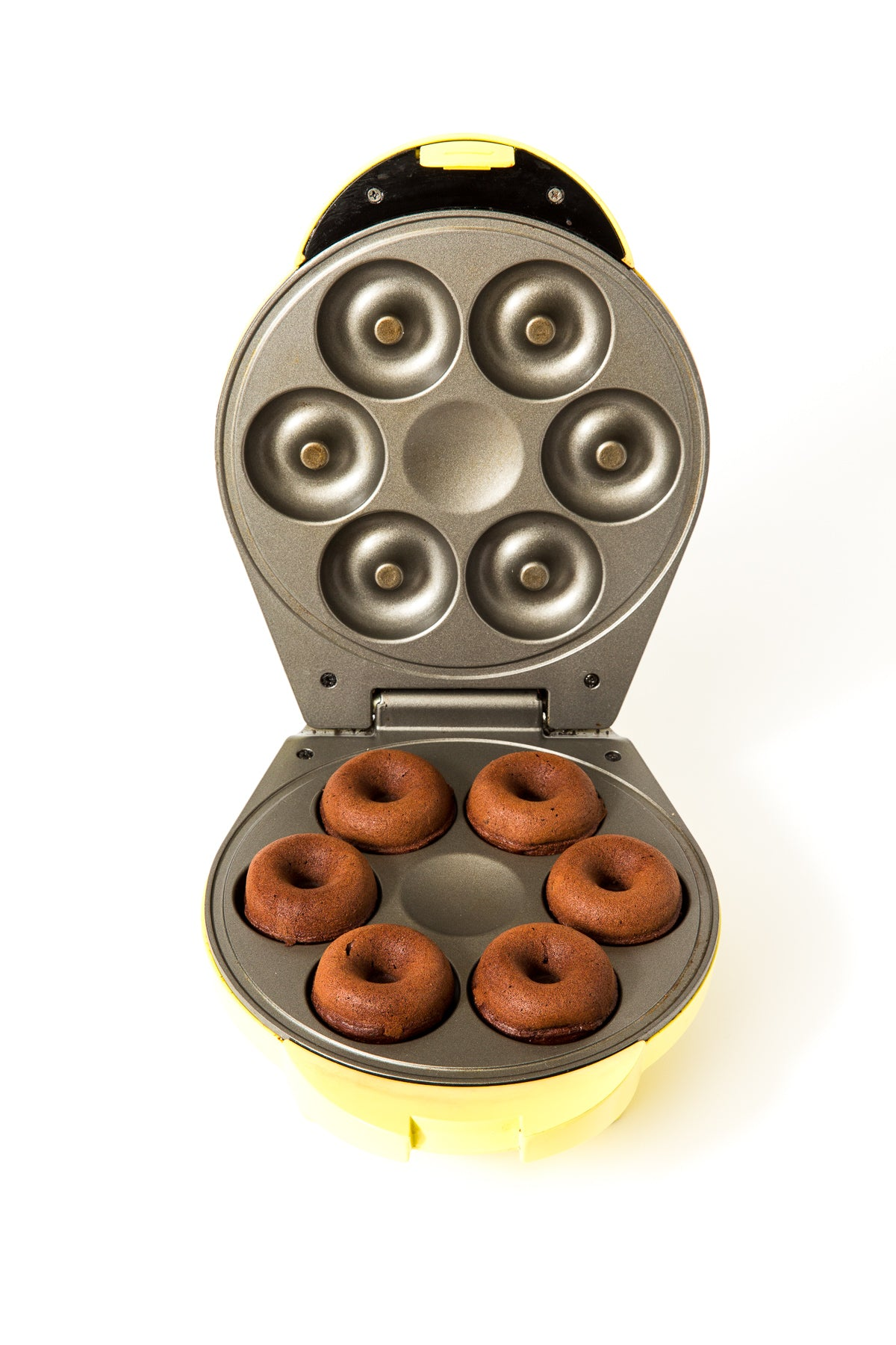 Image of six Miss Jones Baking Co Guinness Glazed Chocolate Donuts in a donut maker mold