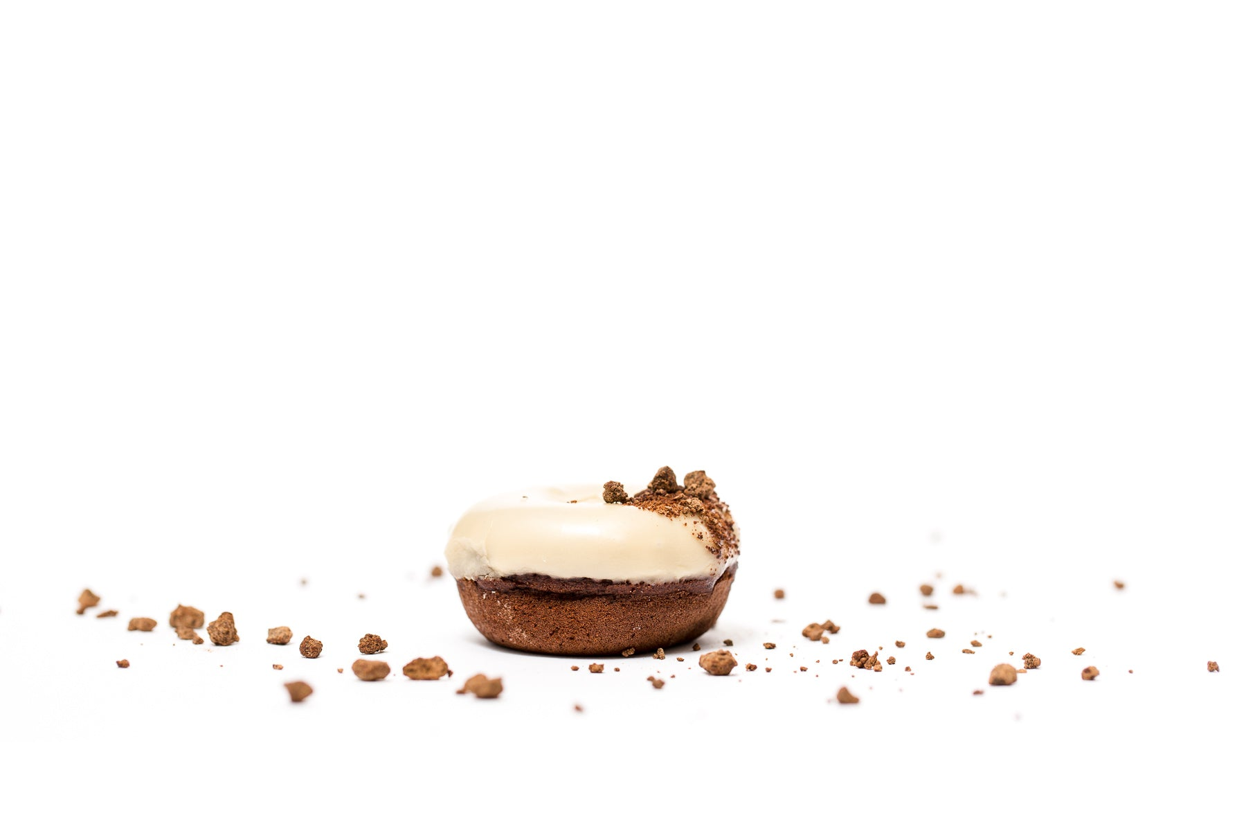 Image of the side of a Miss Jones Baking Co Guinness Glazed Chocolate Donut