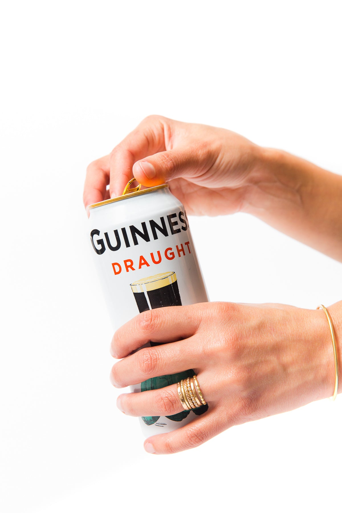 Image of hands opening a can of Guinness Draught for Miss Jones Baking Co Guinness Glazed Chocolate Donuts Recipe
