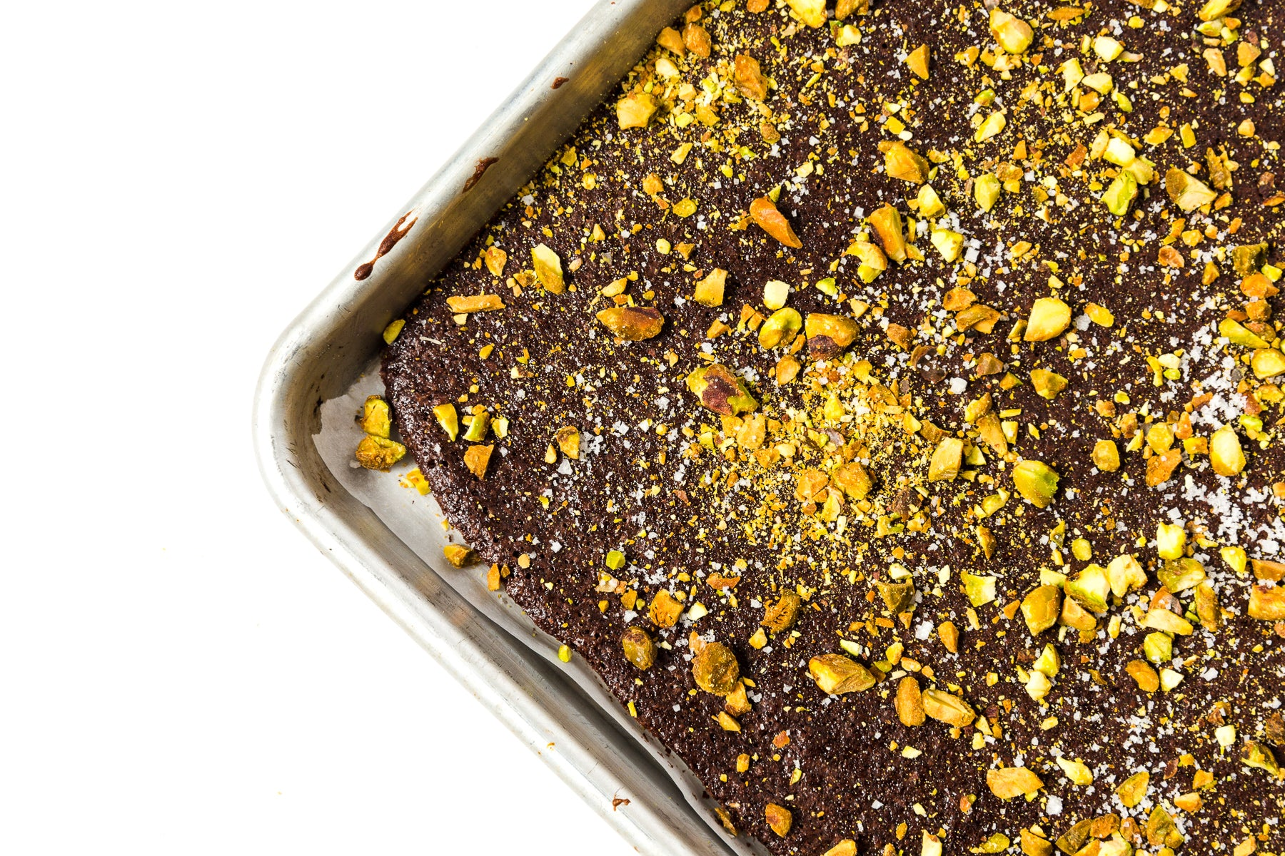 Close up image of pistachio and dark chocolate toppings on Miss Jones Baking Co Brownie Batter Bark
