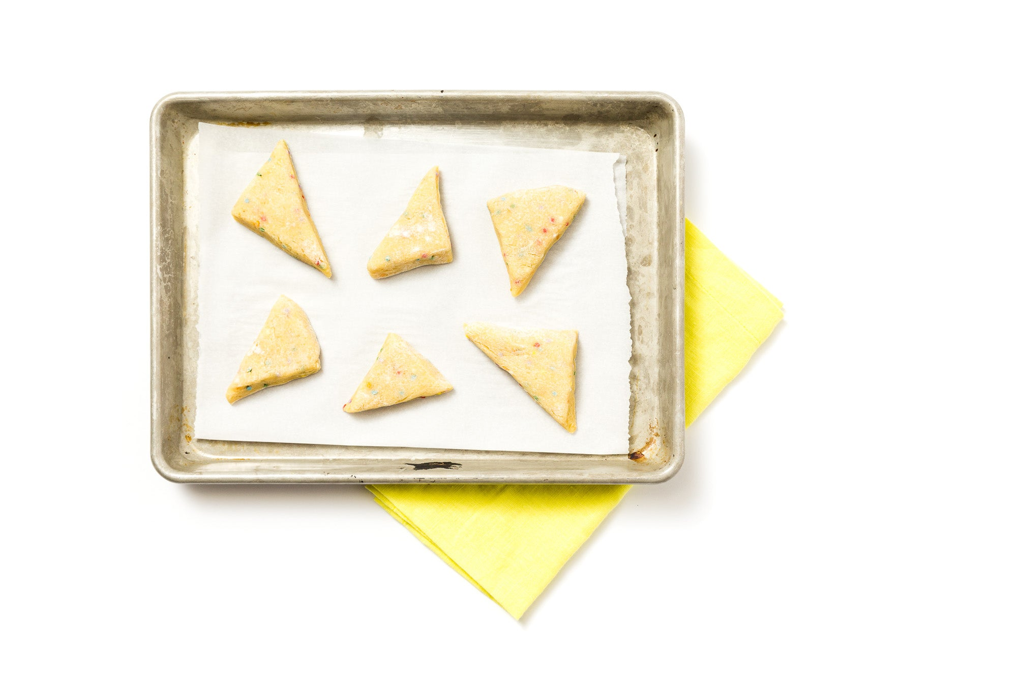 Image from above of a baking sheet with six Miss Jones Baking Co Confetti Pop Cookie Mix Sprinkle Scones dough pieces